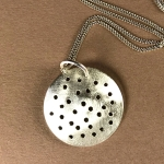 Silver holey pendant