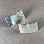 Silver rectangular textured studs